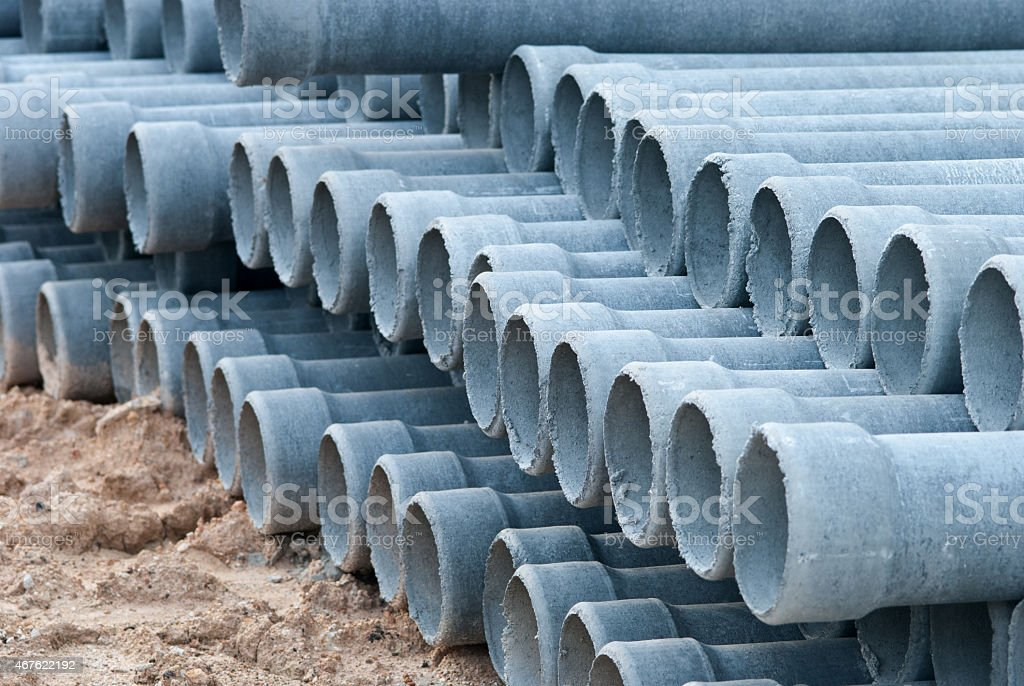 Stack concrete drainage pipe in construction site stock photo