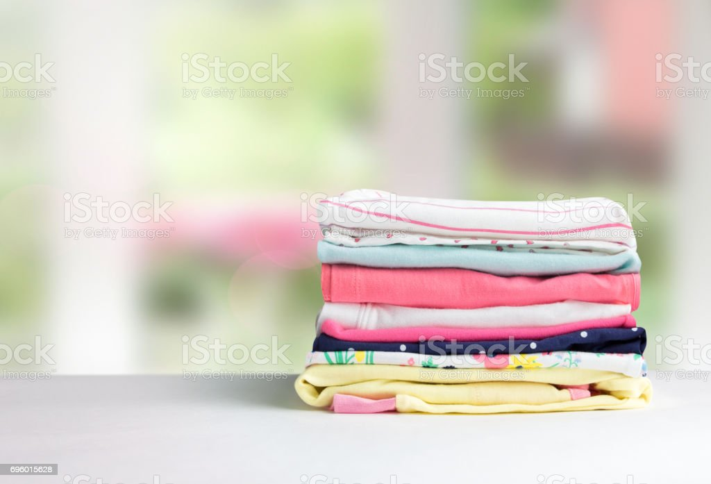 Stack cotton clothes on table empty space background. stock photo