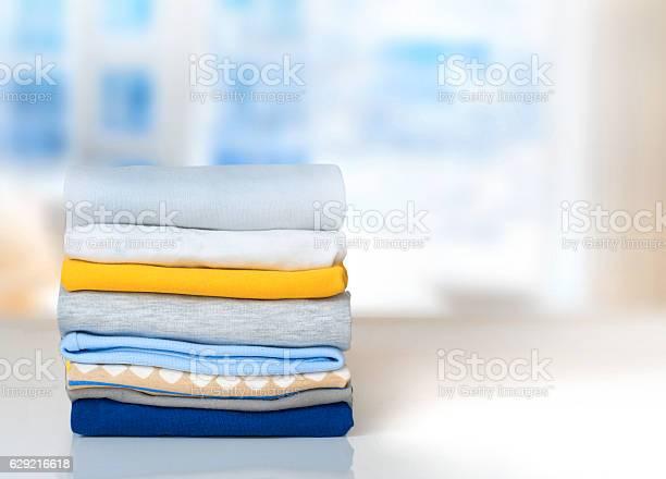 Stack cotton folded clothes on table indoors empty space picture id629216618?b=1&k=6&m=629216618&s=612x612&h=gsu2bhmuxp3j5a32vdju6pffr7b6ccepr6gdurqjeze=