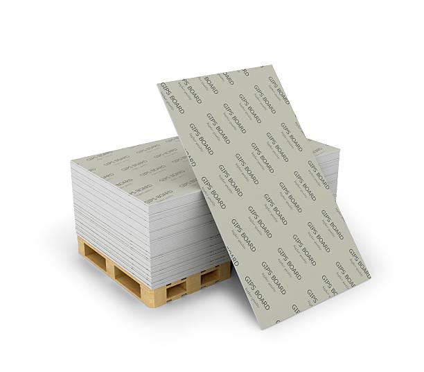 Pilha reboco empilhados em Paletes de madeira e lençóis - foto de acervo