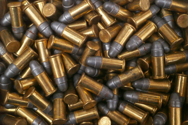 Stack of .22 Short Stack of .22 Short, a variety of .22 caliber (5.6 mm) rimfire ammunition. ammunition stock pictures, royalty-free photos & images