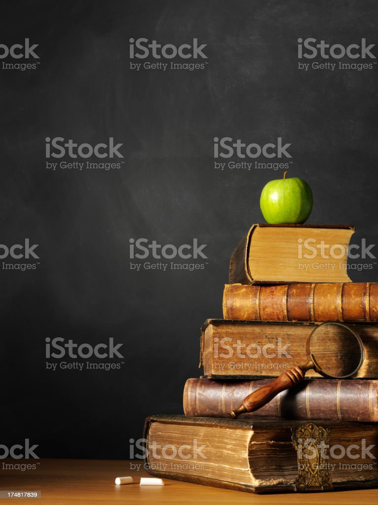 Stack of Antique Books with a Granny Smith Apple royalty-free stock photo