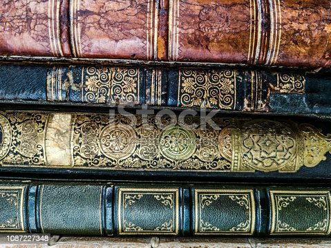 Stack of antique books with classical binding