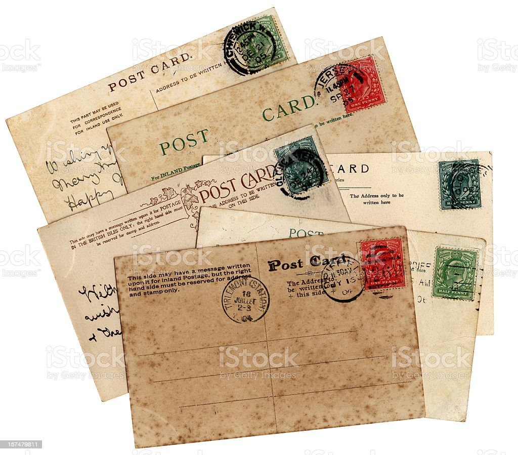 Stack of antiqued Edwardian postcards. stock photo