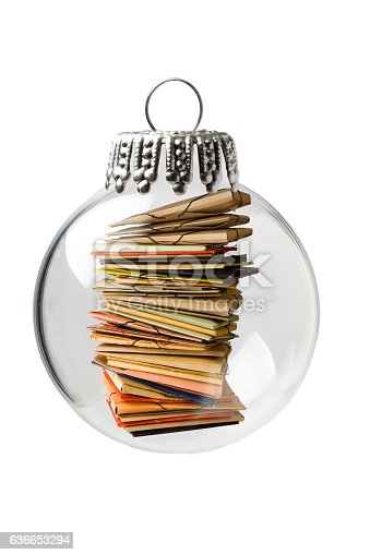 istock Stack of Archives in a Christmas Ornament 636653294
