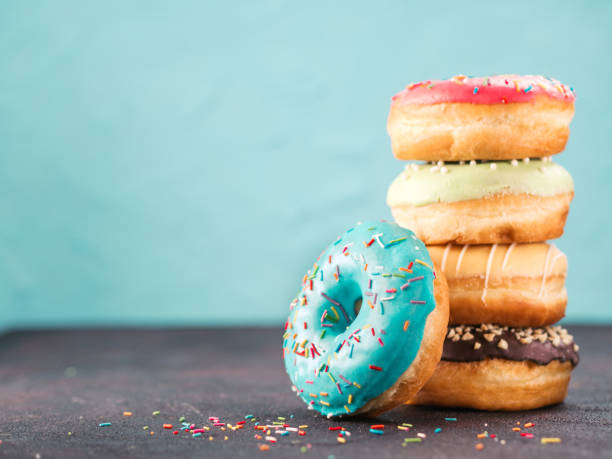 Stack of assorted donuts, copy space stock photo