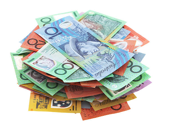 Stack of Australian banknotes on white background stock photo