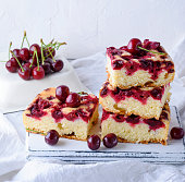 istock stack of baked square pieces of cherry pie 973497668