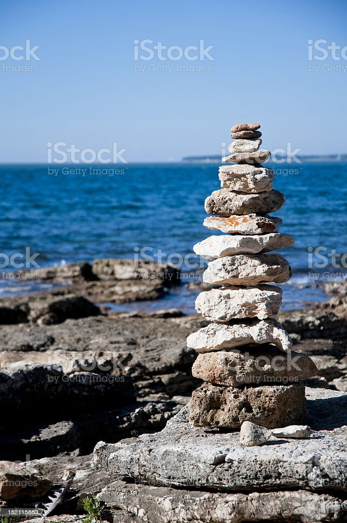 stack of balanced stones on beach stock photo