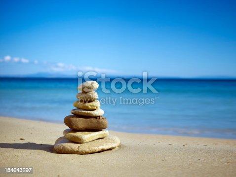 istock Stack of balanced stones on the beach 184643297