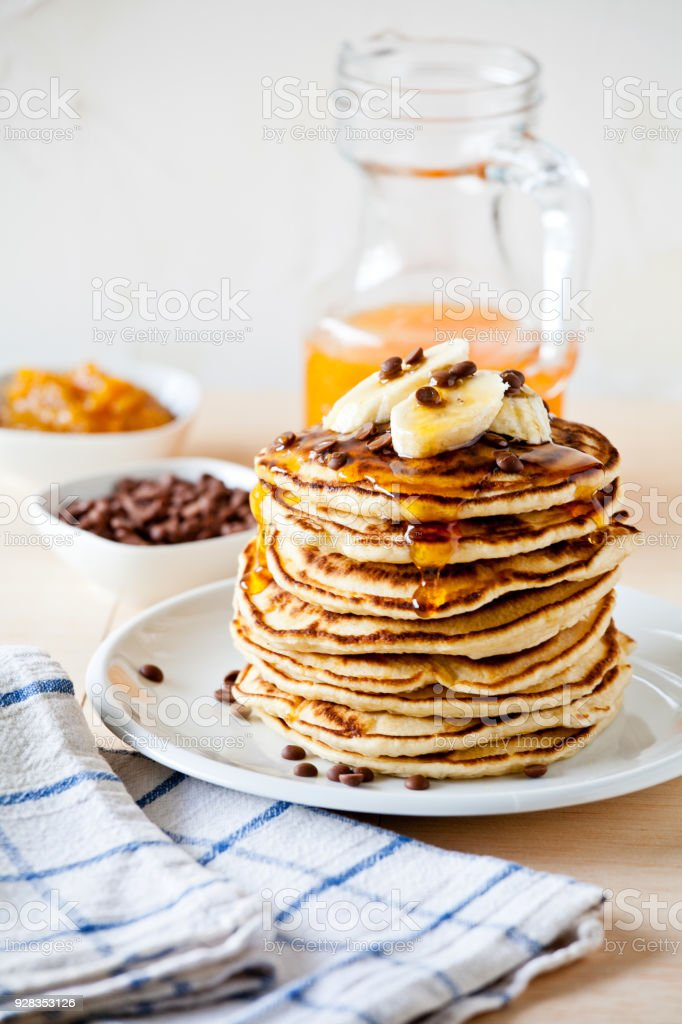 Stack Of Banana And Chocolate Pancakes stock photo