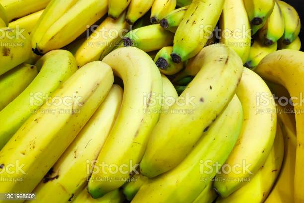 Stack Of Bananas On A Market Stall Stock Photo - Download Image Now