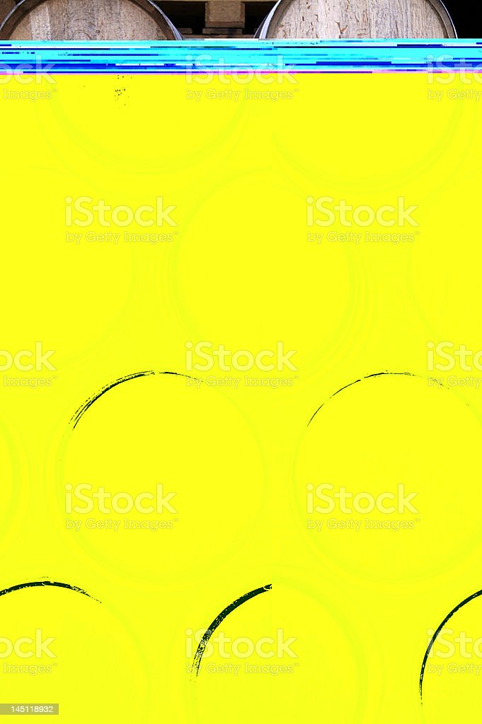 Stack of barrels obscured by yellow block with blue top stock photo