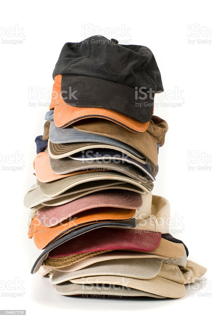 Stack of baseball caps in various colors royalty-free stock photo