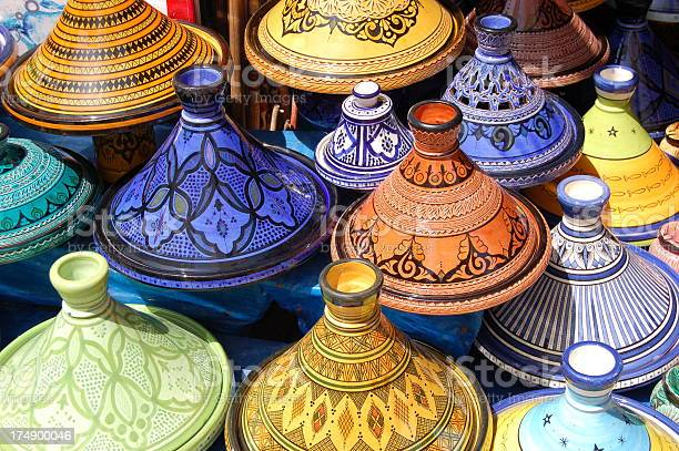 Stack Of Beautiful Colored Moroccan Tajine Pots Stock Photo - Download Image Now