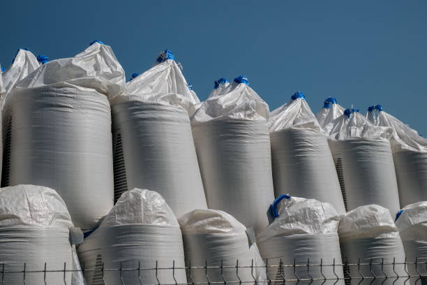 stack of big bags containing sand stock photo