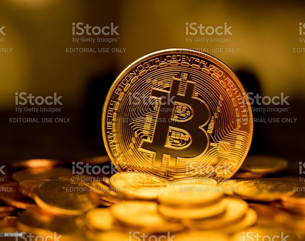 Stack of bitcoins with gold background stock photo