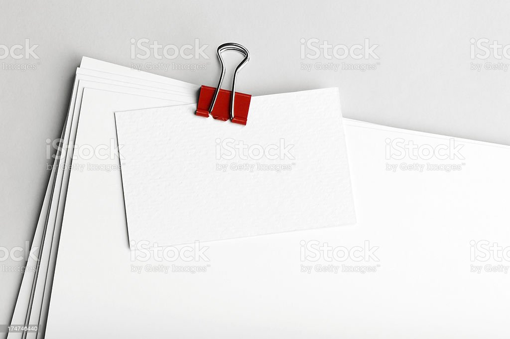 Stack of blank paper with paperclip royalty-free stock photo