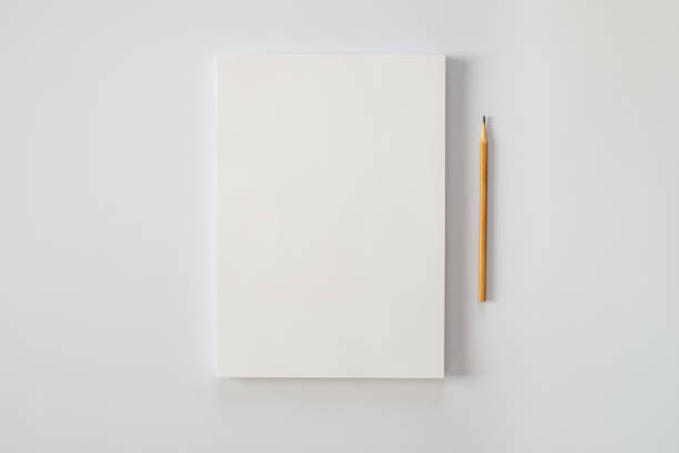 a stack of blank sheets of paper and a pencil on a white background. creative crisis or the beginning of a new novel. - espaço vazio imagens e fotografias de stock