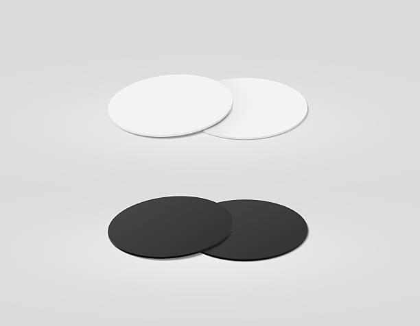 Stack of blank white and black textured beer coasters mockup, foto