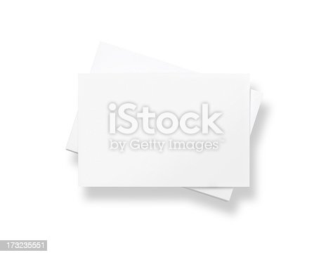 Stack of blank white business cards, isolated on white.