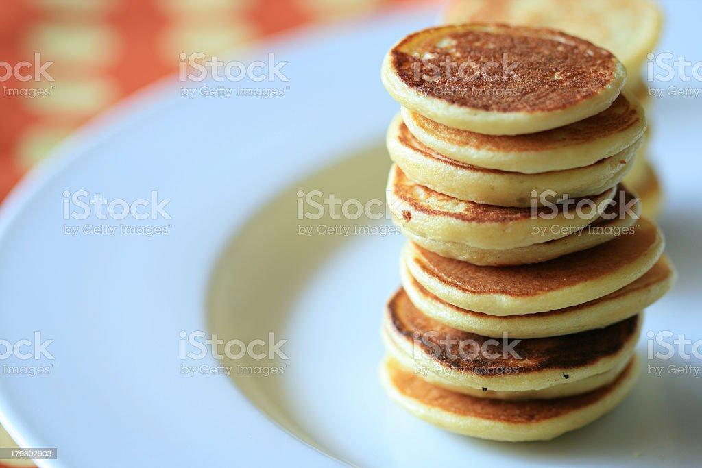 Stack of blini pancakes on a small plate stock photo