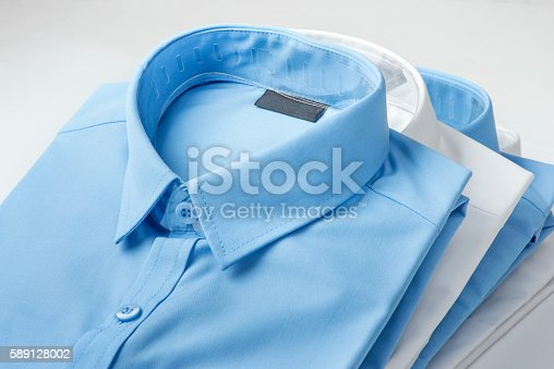 istock Stack of blue and white shirt 589128002