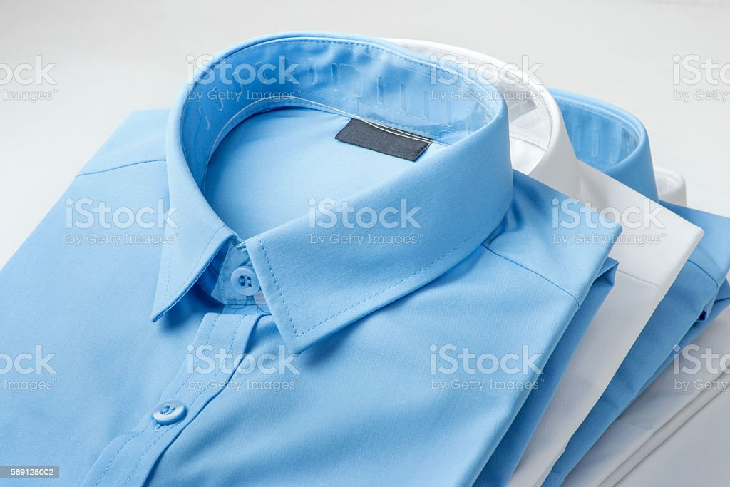 Stack of blue and white shirt stock photo