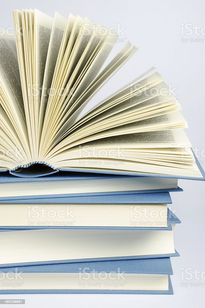 Stack of blue books on light background royalty-free stock photo