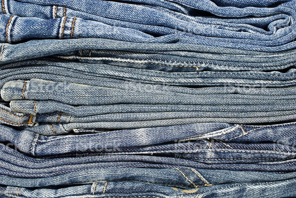 stack of blue jeans closeup royalty-free stock photo