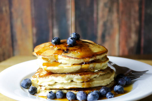 Stack of Blueberry Pancakes with Maple Syrup stock photo