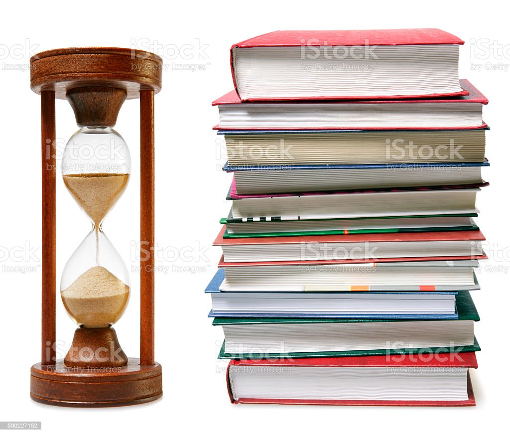 Stack of books and a hourglass - Time to Study stock photo