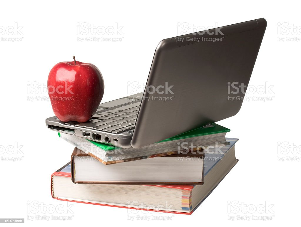 Stack of books and a laptop representing online education stock photo