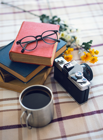 istock Stack of books and cup of coffee 1183621144