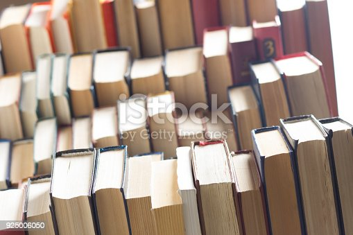 1034955096 istock photo Stack of books background. many books piles. 925006050