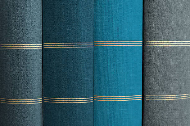 stack of books, book spines in row - four lawyers stockfoto's en -beelden
