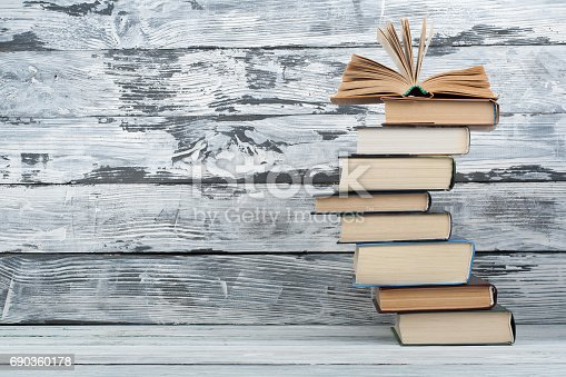 istock Stack of books. Education background. Back to school. Book, hardback colorful books on wooden table. Education business concept. Copy space for text 690360178