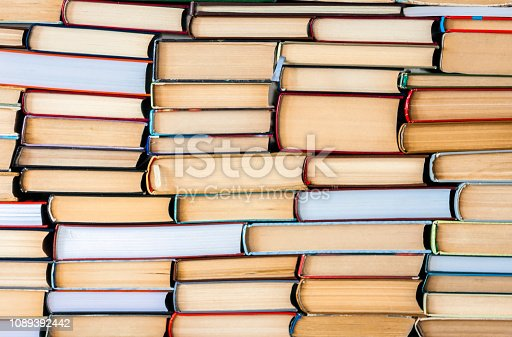 istock Stack of books education concept background, many books piles . 1089392442