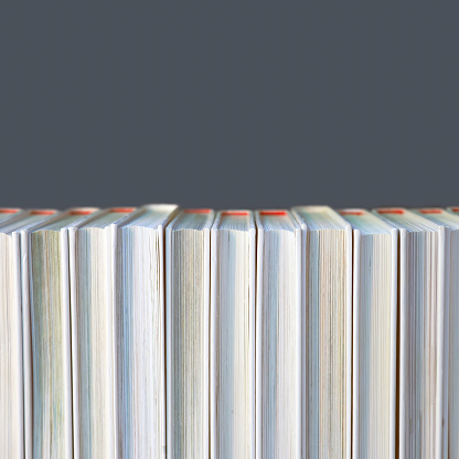 Old pastel books isolated on white background
