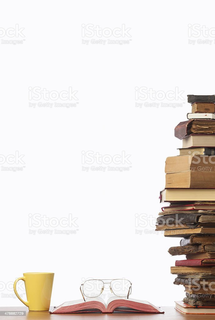 Stack of books, glasses and coffee cup on white background royalty-free stock photo