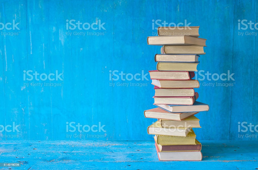 stack of books, grungy background, stock photo