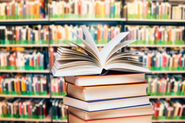 Stack of books in a library stock photo
