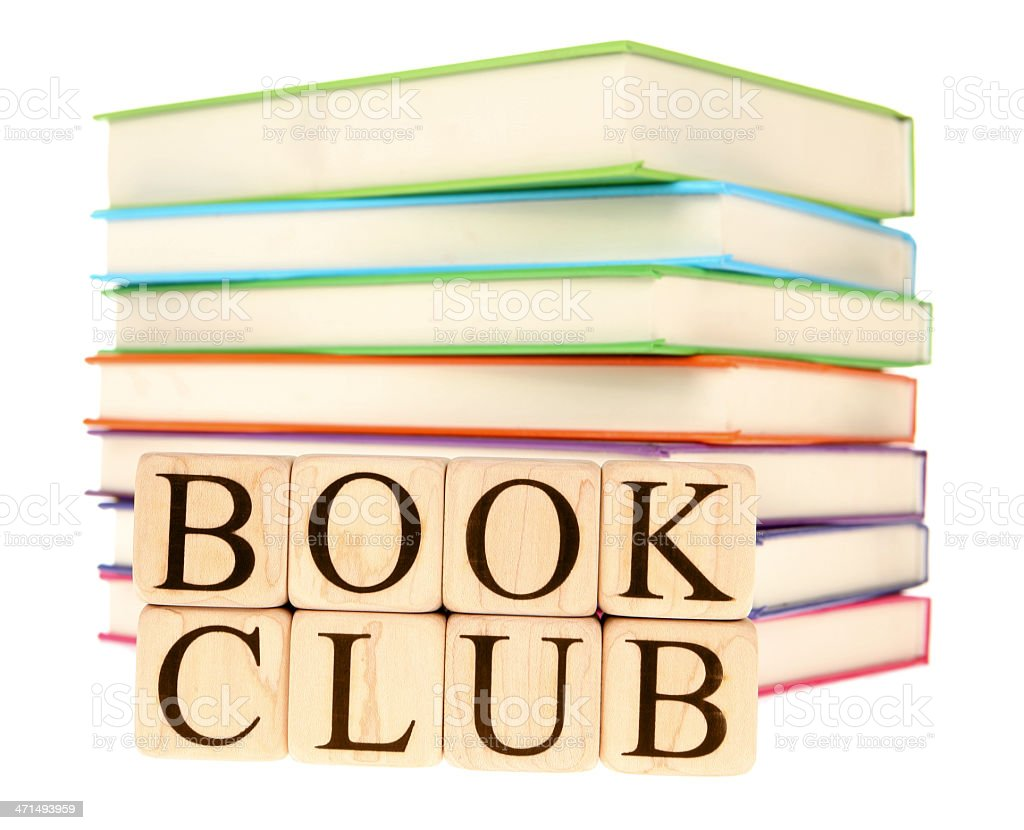 Stack of books in rainbow colors with a wood book club sign stock photo