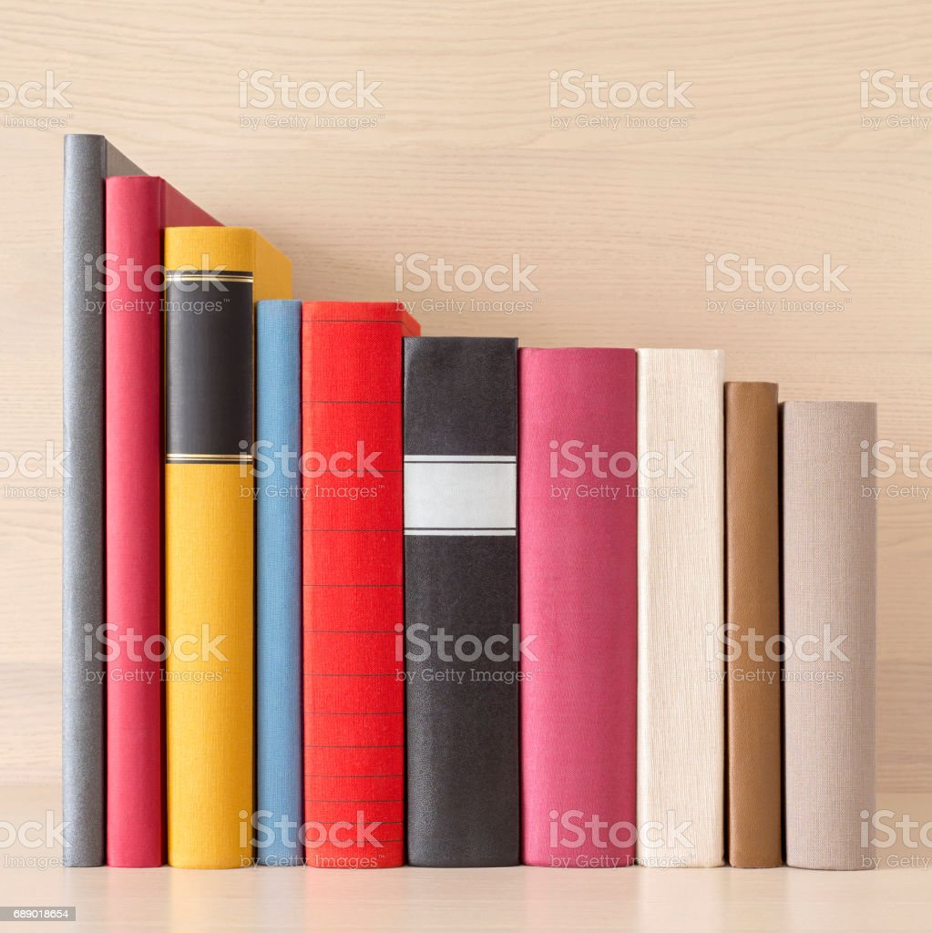 stack of books in the bookself stock photo