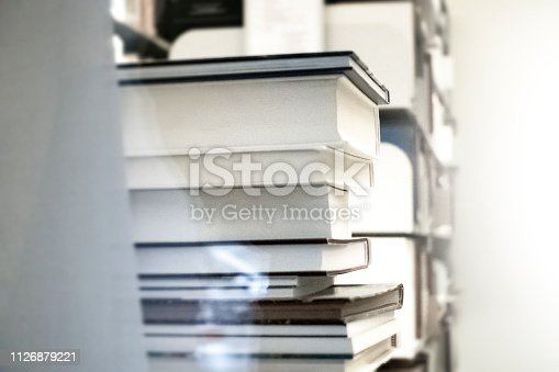 istock A stack of books in the library by the window 1126879221