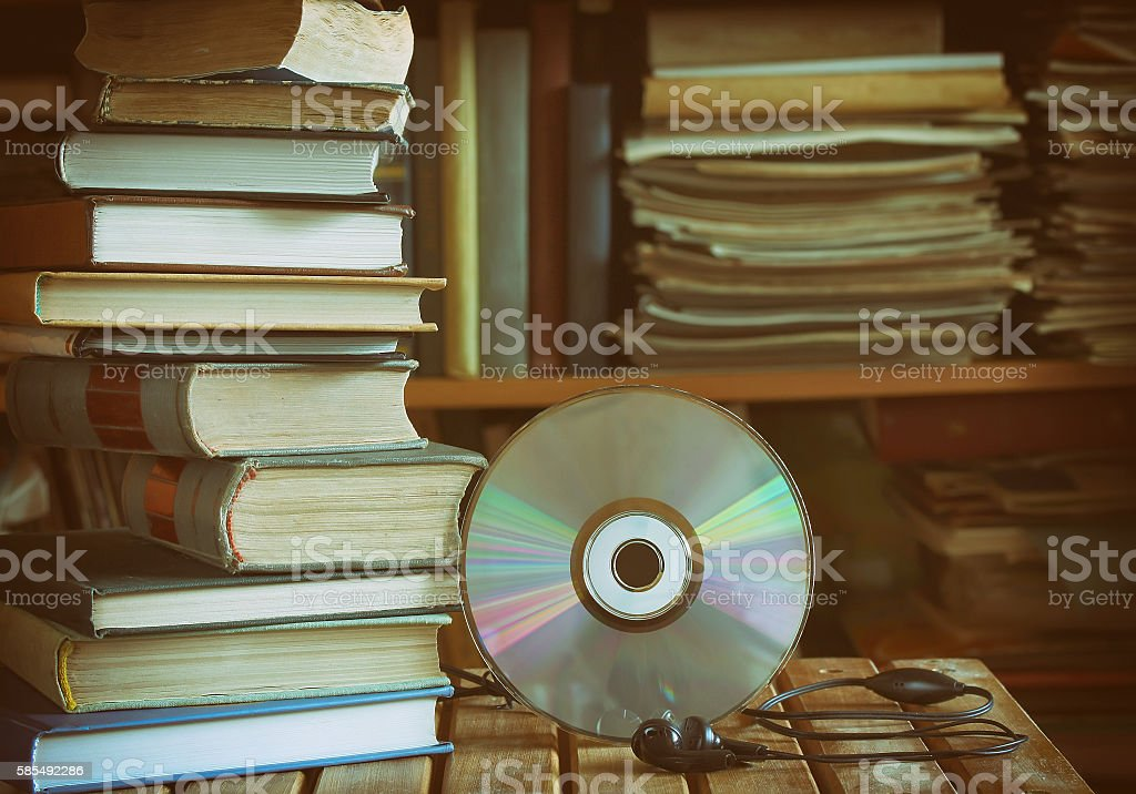 stack of books, library, cd, headphones stock photo