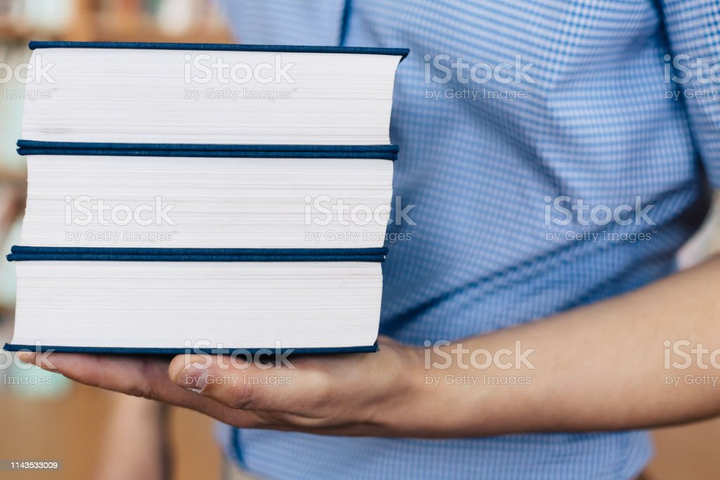 Stack of books lying on the palm royalty-free stock photo