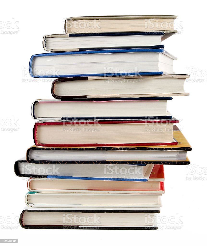 A stack of books of varying thickness. royalty-free stock photo