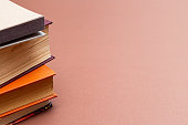 Stack of books on a beige background. Vintage books with copy space