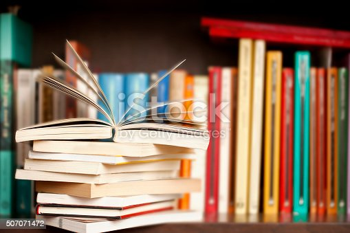 istock Stack of books on a shelf, multicolored book spines. 507071472
